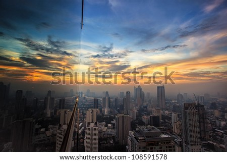 city in the middle of bangkok, sunset. - stock photo