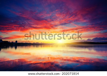 City in twilight. Fantastic colorful sunset and dark ominous clouds. Ternopil, Ukraine, Europe. Beauty world.