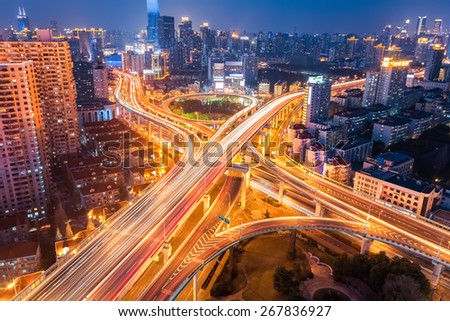 city interchange at night , overpass and viaducts in shanghai