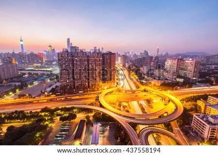 city interchange in guangzhou ,  bright lights and traffic in sunset - stock photo