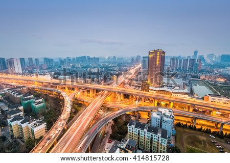 city interchange in nightfall, road junction of urban expressway background - stock photo