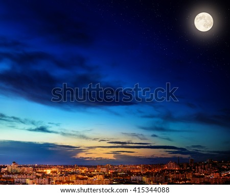 City landscape at nigh with sky filled with stars. Elements of this image furnished by NASA. - stock photo
