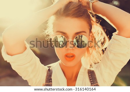 City lifestyle fashion portrait of happy pretty girl walking alone having fun on the street, evening sunlight, retro dress vintage hat, happy positive mood.Sunshine girl - stock photo