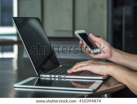 City lifestyle woman hand busy working on home office computer typing laptop keyboard using IOT IT SEO IM wifi cyber internet online digital media technology pc device in urban aerial view environment - stock photo