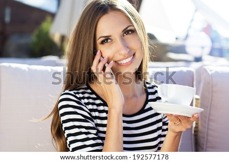 City lifestyle woman using smartphone on cafe - stock photo