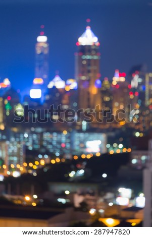 City light blur bokeh, defocused background, at night - stock photo