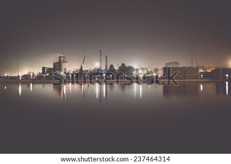 city light reflections over water at the night - retro, vintage style look
