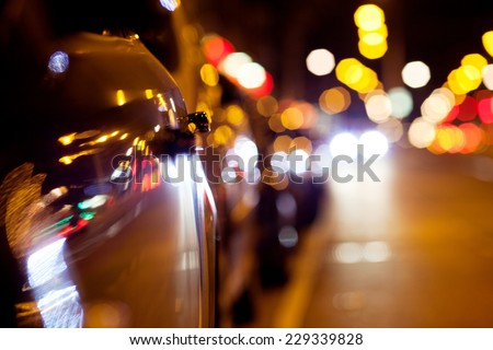 City lights. Background with blurring lights on the road - stock photo