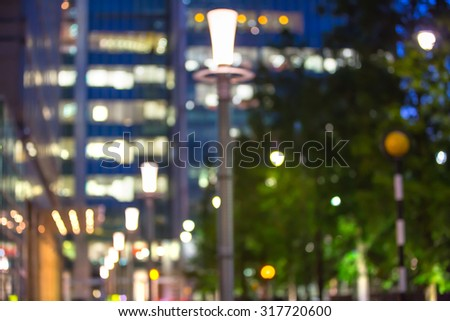 City lights blur background. London, Canary Wharf night life. Traffic, roads, lanterns and lit up office buildings - stock photo