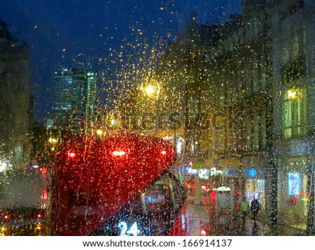 City lights from London bus in rainy night
