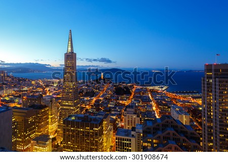 city lights of downtown san francisco and bay at dusk - stock photo