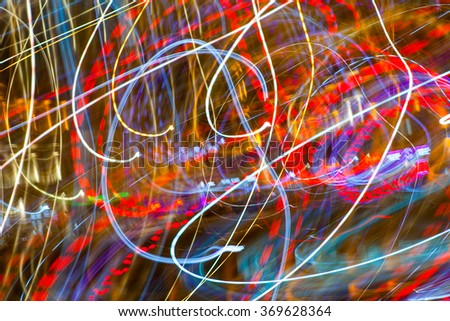 City lights - trails by moving camera. Patterns of night life - stock photo
