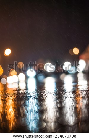 City night headlights, car rides at the rain through the night city - stock photo