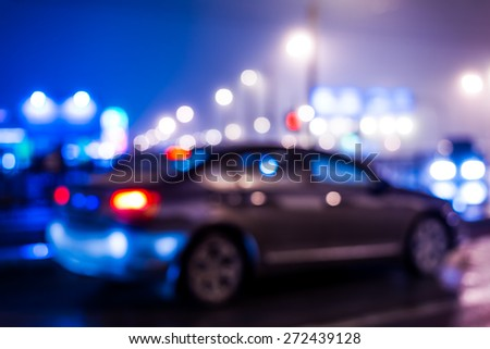 City night lights, car standing at the traffic lights. Defocused image, in blue tones - stock photo
