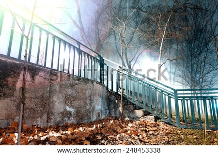 City night scene, fog and stairway.Old wall and fence - stock photo