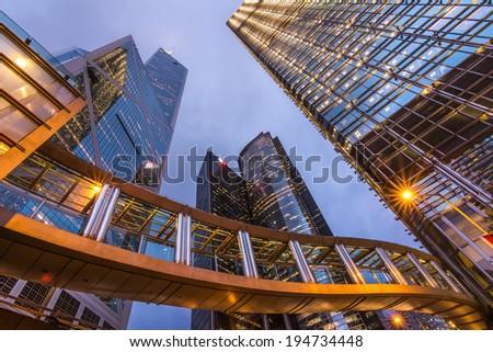 City night scene with modern bridge and skyscraper in Hong Kong, Asia. - stock photo