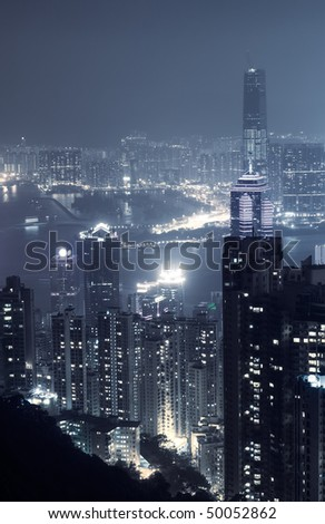 City night scene with modern skyscraper and buildings in Hong Kong, Asia.