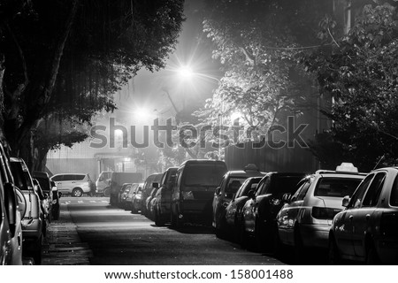 City night with cars parked at small lane under the streetlight, shot at Taipei, Taiwan, Asia. - stock photo