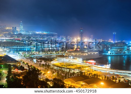 City of Barcelona at night. View on port and cityscape with blue dark sky - stock photo