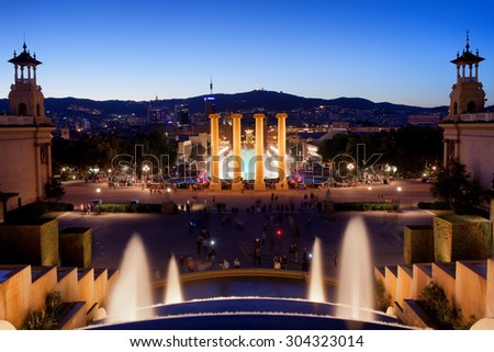 City of Barcelona by night in Catalonia, Spain, view from Montjuic towards Magic Fountain and Four Columns.