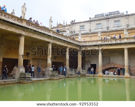 CITY OF BATH, ENGLAND - SEPTEMBER 7: Tourists at the ancient Roman Bath Museum in West England on Sept 7, 2011. The Baths are a major tourist attraction & receive more than 1 million visitors a year. - stock photo