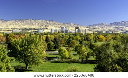 City of Boise Idaho and Autumn trees in a park - stock photo
