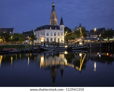 City of Breda, Netherlands, at night, showing the beautifully lit tower of the big church in the center of the city