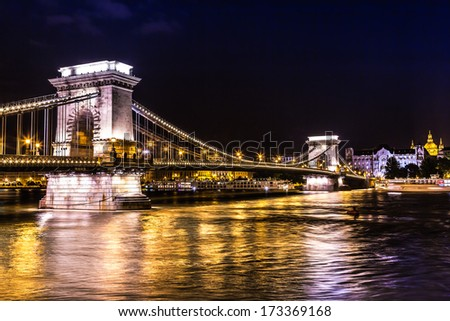 City of Budapest in Hungary night urban scenery, street on the Szechenyi Chain Bridge (Hungarian: Szechenyi lanchid).