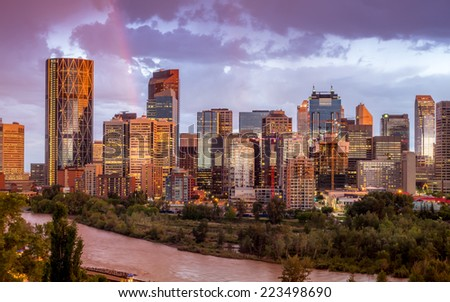 City of Calgary skyline glows during an interlude in a storm.  - stock photo