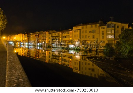 City of Castres in France. Night cityscape in late summer 2017. This city is named the french Venice because of its buildings right upon the river. Beautiful reflections in the water