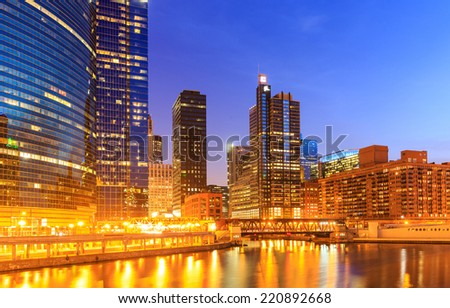 City of Chicago downtown riverside at night. - stock photo