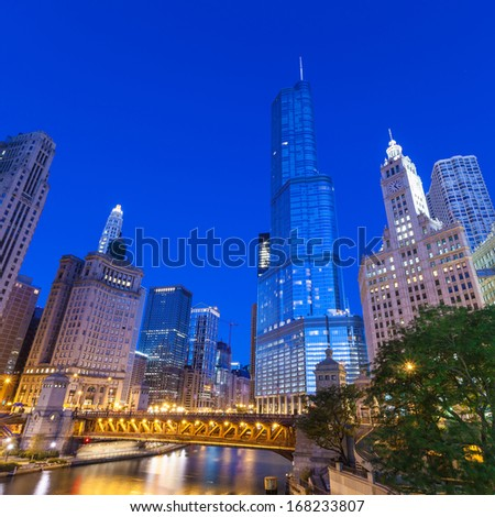 City of Chicago. Image of Chicago downtown and Chicago River with bridges at twilight.