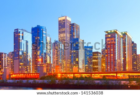 City of Chicago USA,   colorful sunset panorama skyline of downtown with illuminated business buildings - stock photo