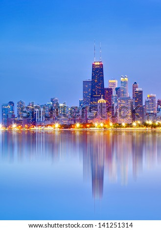 City of Chicago USA, sunset colorful panorama skyline of downtown with illuminated business buildings with reflections - stock photo