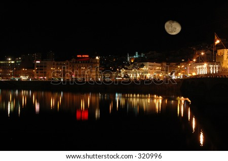 City of Coimbra  in Portugal  by night whit a big moon