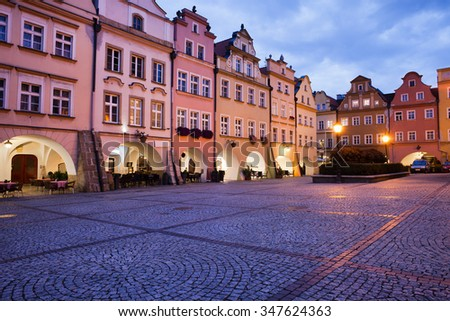 City of Jelenia Gora in Poland, Old Town Market Square with gabled historic houses with arcades in the evening, Lower Silesia Voivodeship.