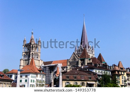 City of Lausanne in the west of Switzerland with blue sky - stock photo