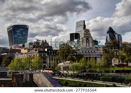 City of London - landscape hdr with dramatic clouds on the sky - stock photo
