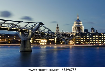 City of London, Millennium bridge and St. Paul's cathedral by night - stock photo