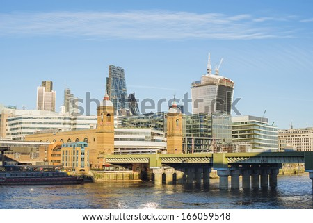 City of London on Thames. Sun light and blue sky - stock photo