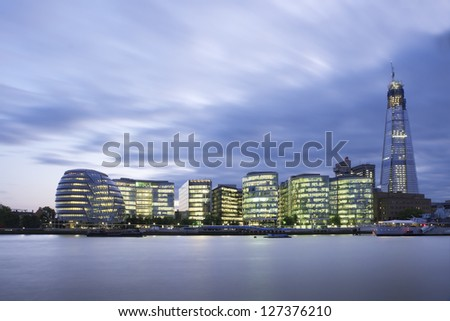 City of London Skyline At Sunset. New London City Hall at night , panoramic view from river. - stock photo
