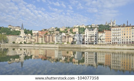 City of Lyon reflected in river saone, France - stock photo