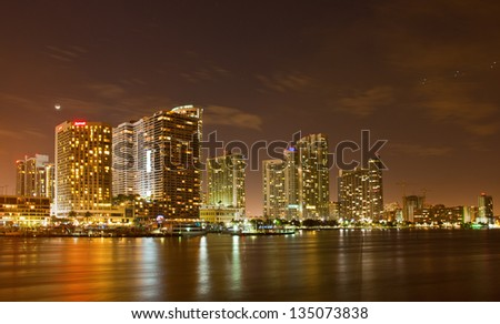 City of Miami Florida, colorful night panorama of downtown business and residential buildings - stock photo