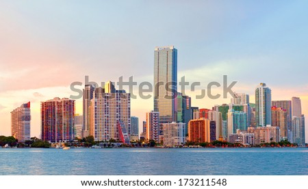 City of Miami Florida, night skyline. Cityscape of residential and business buildings illuminated at sunset   - stock photo