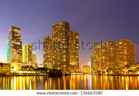 City of Miami Florida, night skyline. Cityscape of residential and business buildings lit by bright lights after sunset - stock photo