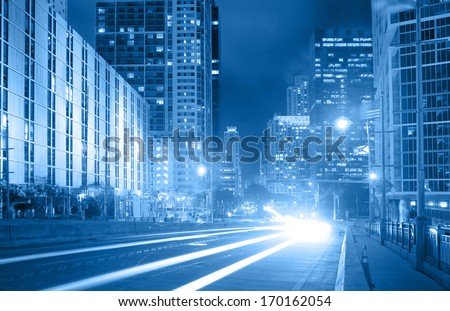 City of Miami Florida, traffic moving through downtown Brickell financial district, blue color processed photo - stock photo
