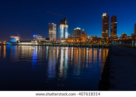 City of Milwaukee Wisconsin at Night lakefront lights reflection in lake Michigan - stock photo
