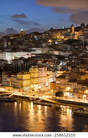 City of Porto in Portugal at night. Old Town by the Douro river. - stock photo