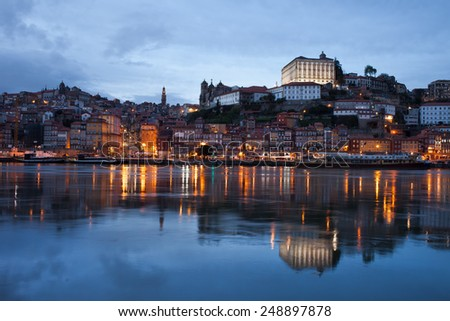 City of Porto skyline at dusk with reflection on river Douro in Portugal. - stock photo
