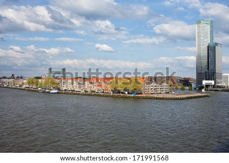 City of Rotterdam cityscape with apartment houses on a river island in South Holland, the Netherlands. - stock photo